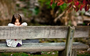 sad-girl-sitting-on-bench